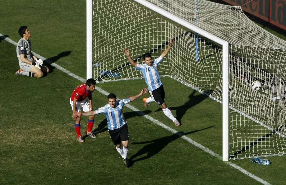 Gonzalo Higuain and Sergio Aguero celebrate after one of Higuain's three goals during Argentina's 4-1 World Cup group B win over South Korea Thursdday at Soccer City in Johannesburg, South Africa.(Associated Press) Photo: ASSOCIATED PRESS / AP