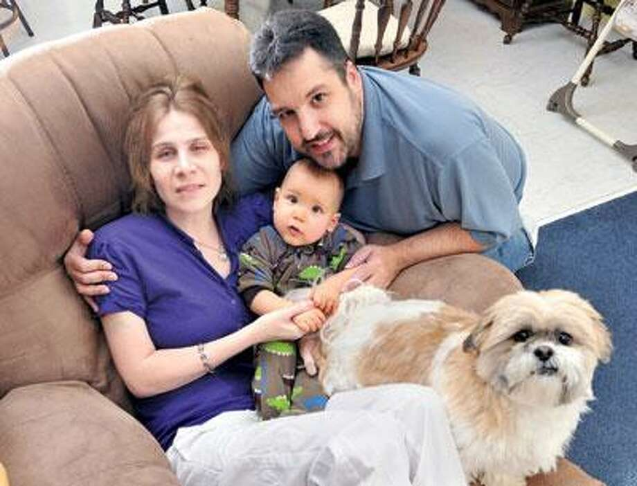 Salvatore and Kathleen Valvo welcomed their baby, Marc, last year, but an illness now threatens Kathleen's life. (Peter Casolino/Register)