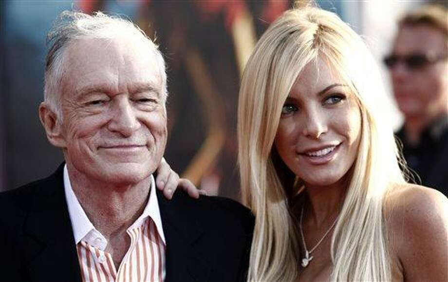 "FILE - Hugh Hefner, left, and Crystal Harris arrives at the premiere of ""Iron Man 2"" at the El Capitan Theatre in Los Angeles in this April 26, 2010 file photo. Hefner says he's gotten engaged again. Hefner said in a Twitter message early Saturday Dec. 24, 2010 that he'd given a ring to girlfriend and Playmate Crystal Harris, saying she burst into tears. (AP Photo/Matt Sayles, File) Photo: AP / AP2010"