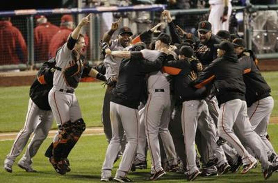 The San Francisco Giants celebrate after their 3-2 win in Game 6 of the National League championship series over the Phillies on Saturday in Philadelphia. (Associated Press/Eric Gay) Photo: AP / AP