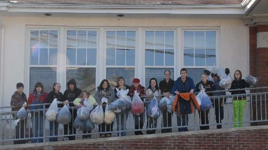 Band members deliver coats to Harbor Healthcare Services in Branford. Frank Schneer/For the Register