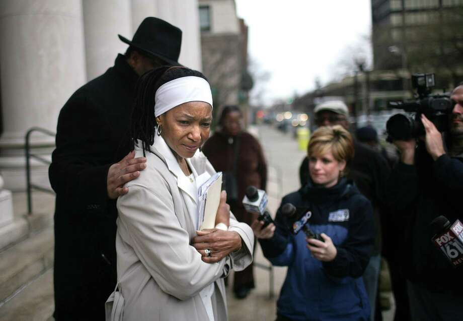 In this file photo from April 2009, Emma Jones, mother of Malik Jones, who was shot to death by an East Haven Police Officer in 1997, is comforted by Alderman Yusuf I. Shah as she held a press conference on the steps of the U.S. District Court in New Haven. Photo/Peter Casolino **