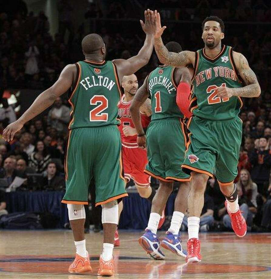 New York Knicks forward Wilson Chandler (21) celebrates with guard Raymond Felton (2) in the fourth quarter of the Knicks 103-95 win over the Chicago Bulls in their NBA basketball game at Madison Square Garden  in New York, Saturday, Dec. 25, 2010.  (AP Photo/Kathy Willens) Photo: AP / AP