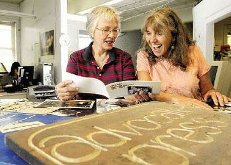 Marleen Cenotti, right, owner of Advocate Press, reminisces with former employee Virginia Blaisdell. The printing business is closing after more than 40 years. (Peter Hvizdak/Register)