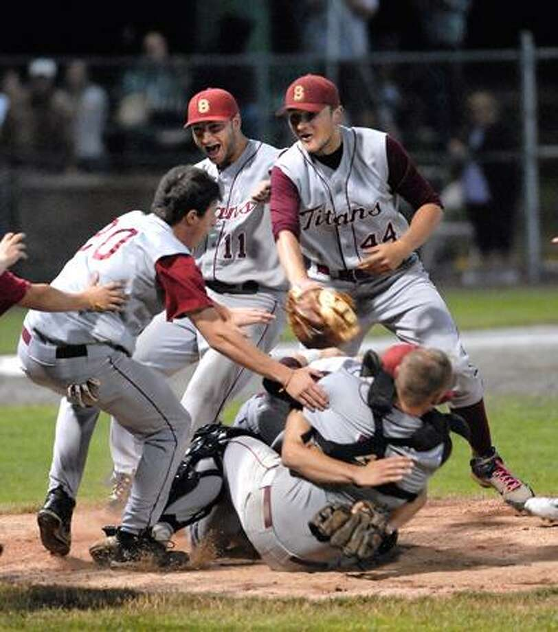 Sheehan players celebrate their 9-4 Class L state championship win over Notre Dame-West Haven on Friday. Pitcher Ryan Moore and catcher Timothy Bickford are about to be at the bottom of the pile. (Peter Casolino/Register)
