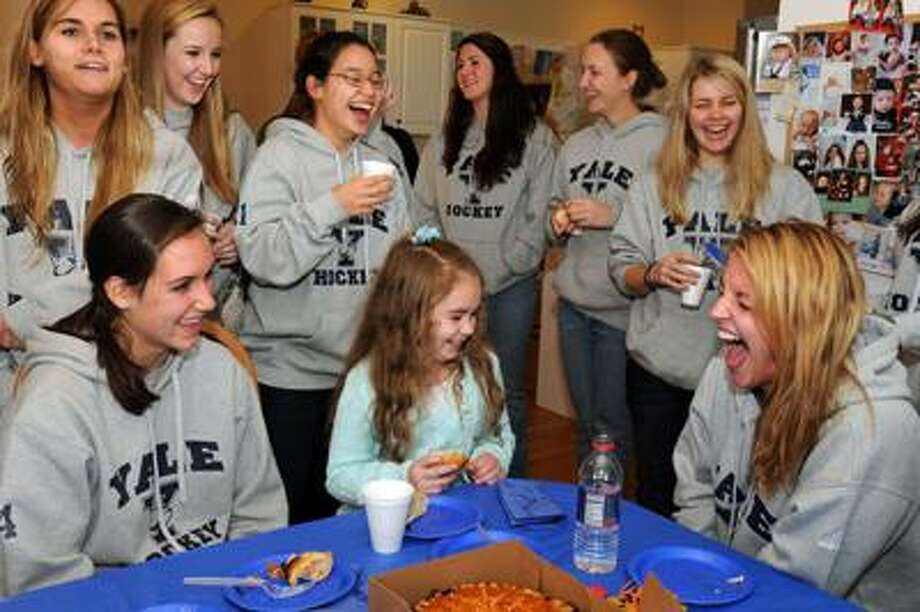 "Guilford--The Yale Women's hockey team has ""adopted"" nine-year-old Giana Cardonita of Guilford who recently had a benign brain tumor removed. Giana still has many health issues associated with the tumor. The team met her at her home and shared lunch with her and her family. Photo by Mara Lavitt/New Haven Register11/7/10"