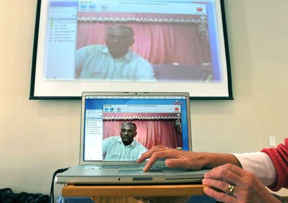 Father John Kuzhikottayil (assistant Pastor at St. Mary's Church in Branford), who is in Delhi India at an orphanage that is sponsored by the church talks to students from St. Mary's School via Skype from Delhi, India. Kuzhikottayil is on a visit to the orphanage. (Photo/Peter Casolino)