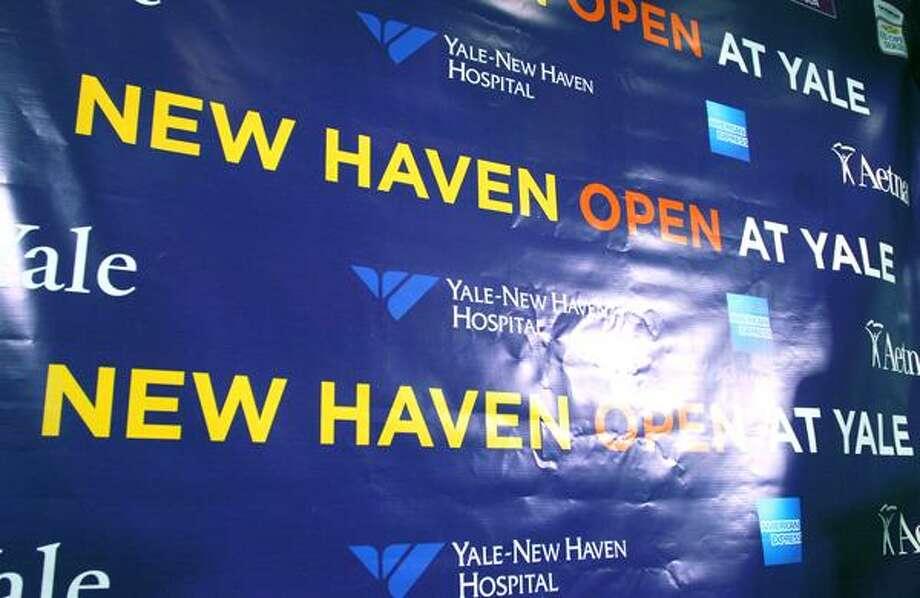 Anne Worcester announces the specifics of the New Haven Open at Yale women's tennis tournament as Mayor John DeStefano Jr. looks on. Brad Horrigan