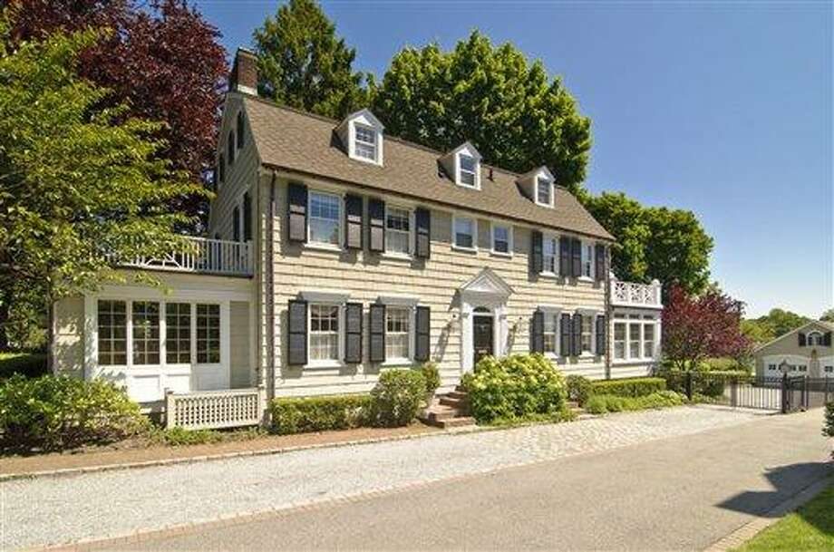"""FILE - In this photo provided by Daniel Gale Sotheby's International Realty, the house made famous in the 1979 film """"The Amityville Horror"""" is shown in this May 20, 2010 file photo taken in Amityville, N.Y.. Since the house is under contract the current owner of the New York house is holding a moving sale Saturday Aug. 21, 2010. (AP Photo/Daniel Gale Sotheby's International Realty, Kevin J Wohles) Photo: AP / AP2010"""