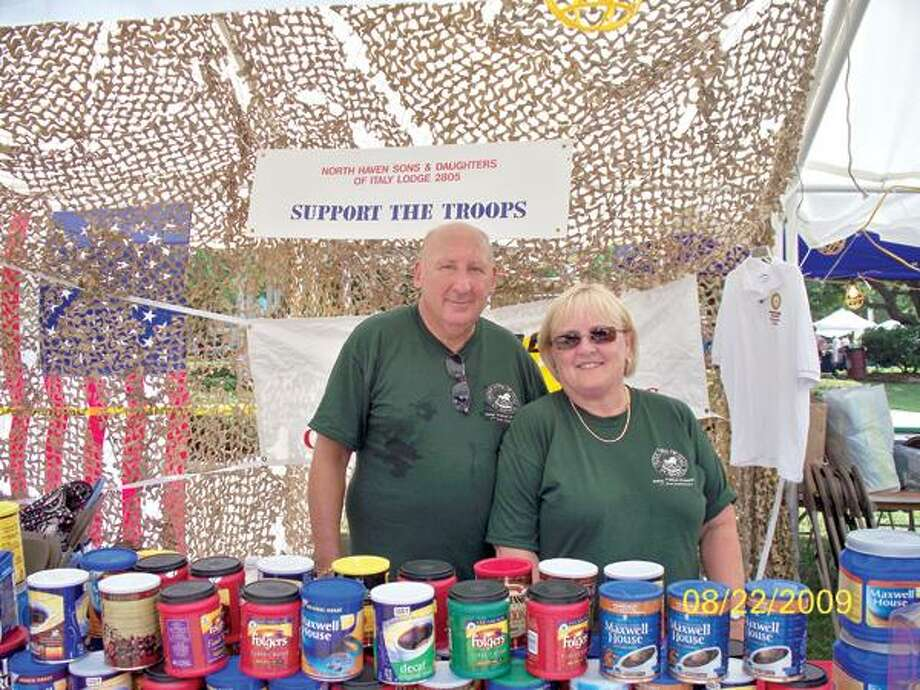 Len and Pat Stepleman collected coffee and old cell phones for the troops at last year's Festival of the Angels. Photo courtesy Italian Festival of Angels