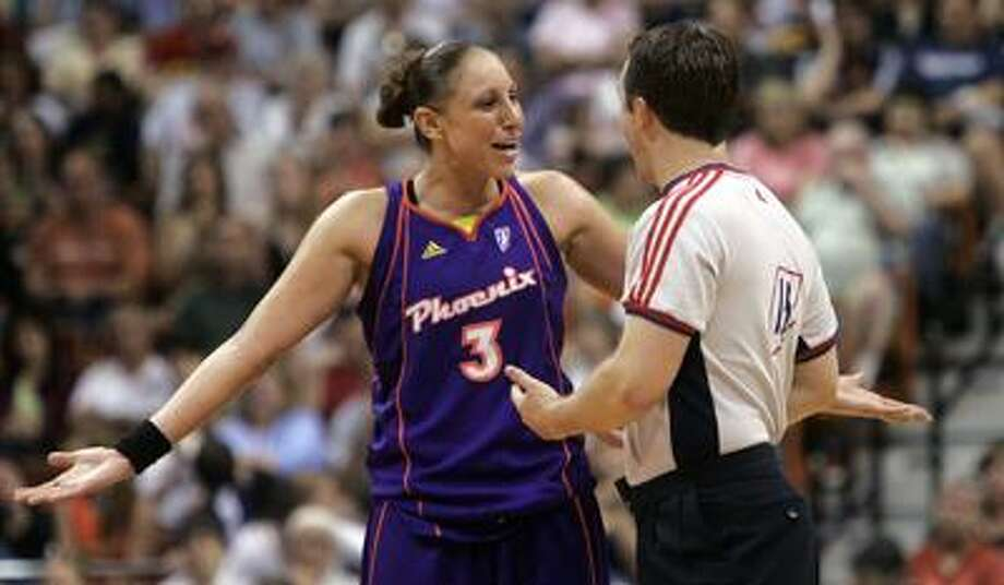 Phoenix Mercury's Diana Taurasi speaks with official Scott Twardowski after she was called for a technical foul in the second half of a WNBA game against the Connecticut Sun in Uncasville, Conn., Sunday, June 29, 2008. The Mercury defeated the Sun 87-80 with Taurasi the high scorer for the Mercury and the game with 25 points.  (AP Photo/Bob Child) Photo: ASSOCIATED PRESS / AP2008