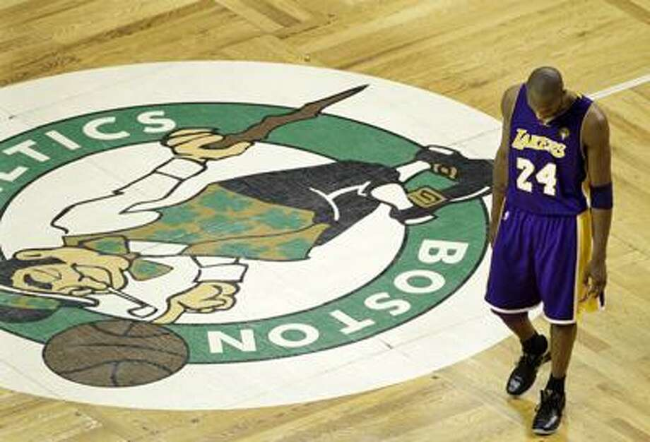 Lakers guard Kobe Bryant walks past the Celtics logo at center court during the fourth quarter of Los Angeles' 92-86 NBA finals Game 5 loss Sunday night in Boston. The two teams play Game 6, with the Celtics leading the series 3-2, tonight in L.A. (Associated Press) Photo: AP / AP