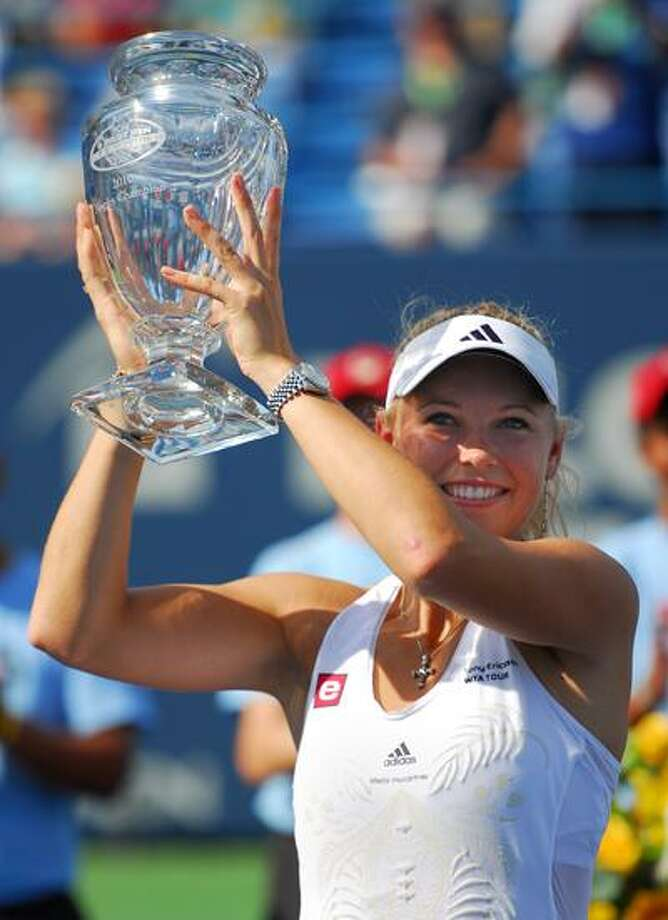 Caroline Wozniacki raises the cup after winning her third consecutive Pilot Pen Tennis championship this past August. The tournament will return to New Haven in 2011. (Brad Horrigan/Register)
