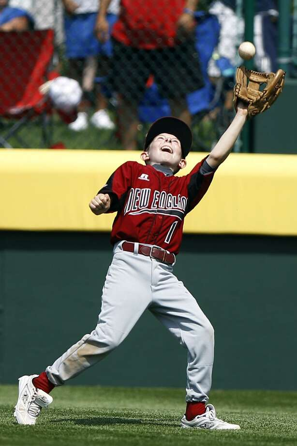 Fairfield, Conn., right fielder Nate Klein catches a pop fly out by Auburn, Wash. batter Dillon Row in the sixth inning of a pool play baseball game at the Little League World Series, Friday, Aug. 20, 2010, in South Williamsport, Pa. Connecticut won 3-1. (AP Photo/Matt Slocum) Photo: ASSOCIATED PRESS / AP