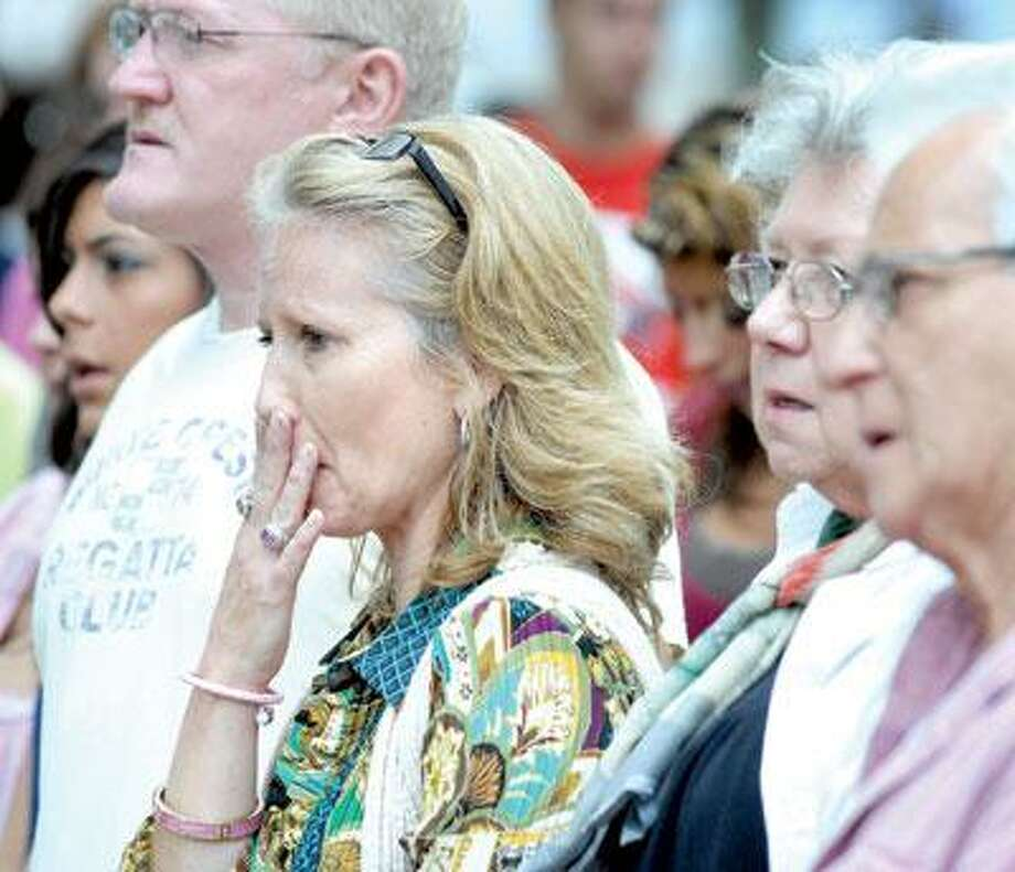 From left, Giulio Cavalli, father of Viviana Cavalli; Dee Tutka, mother of Viviana Cavalli; and Tutka's parents, Joyce and David Souza, listen to a remembrance eulogy at the start of the Shelton Butterfly Project in honor of Viviana at the Riverwalk Park in Shelton Sunday.