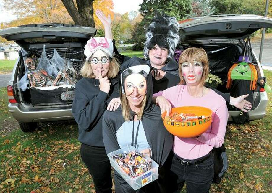 Peter Casolino/Register phoro, North Branford Parks and Recreation director Pamela Gery, front, and her staff, Debbie Ferrucci, left, Denise Regino and Lauren Munro, are hosting a Trunk-Or-Treat event on Halloween at Totoket Valley Park. The event will allow children to trick-or-treat around the park at various cars instead of going door to door. There will also be a bonfire, horse-drawn carriage rides and a costume contest.