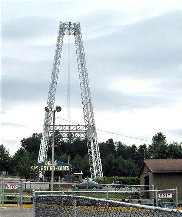 "In this July 30, 2010, file photo is the Terminal Velocity free-fall ride at Extreme World in Lake Delton, Wis. An amusement park worker ""blanked out"" and never say an all-clear signal before he let a Florida girl plunge 100 feet to the ground. Charles A. Carnell, of Lake Delton, was charged Wednesday with one count of first-degree-reckless injury, a felony punishable by up 25 years in prison and $100,000 in fines in the July 30 incident. (AP Photo/Wisconsin State Journal, Gena Kittner, File) Photo: AP / WISCONSIN STATE JOURNAL"