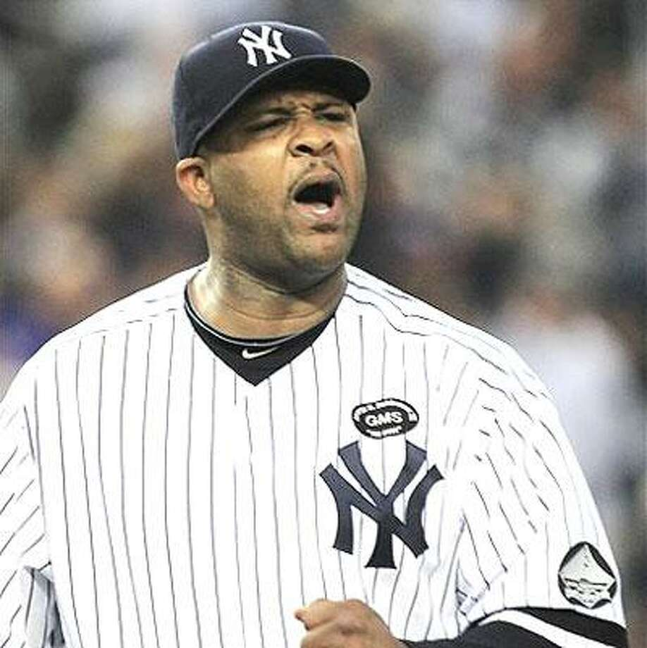 New York Yankees starting pitcher CC Sabathia reacts after a double play to end the top of the fifth inning of Game 5 of baseball's American League Championship Series against the Texas Rangers Wednesday, Oct. 20, 2010, in New York. (AP Photo/Charles Krupa)