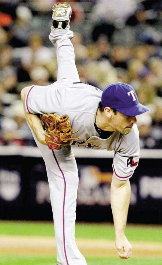 Cliff Lee struck out 13 and threw eight shutout innings as the Texas Rangers beat the New York Yankees 8-0 to take a 2-1 series lead in the American League championship series on Monday. (Associated Press)
