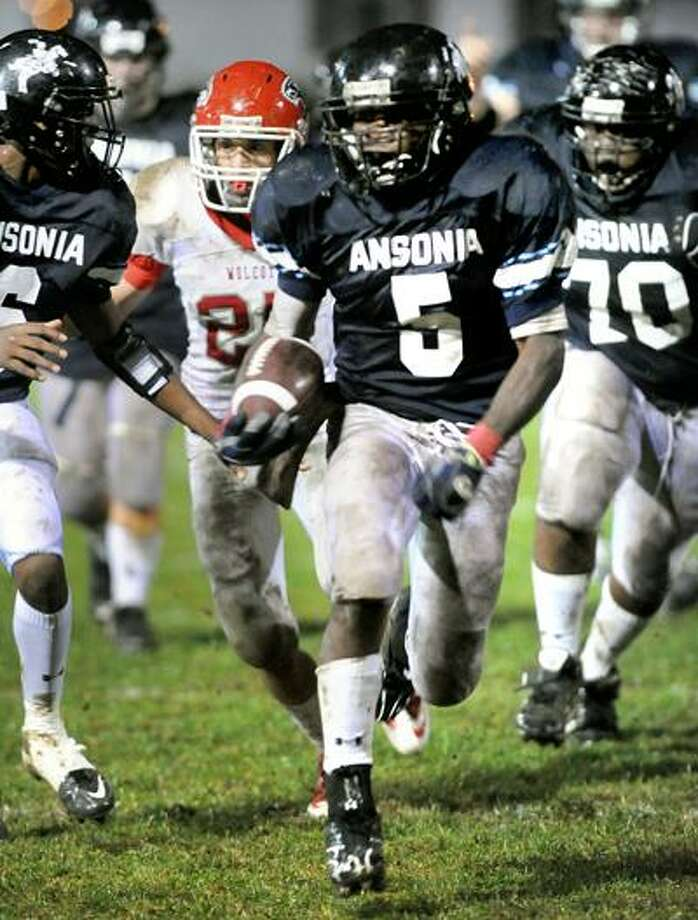 Ansonia's Montrell Dobbs (5) was one of the state's top offensive players of the week, rushing for 305 yards and three touchdowns in a 39-20 win over previously unbeaten Wolcott on Friday night in Ansonia. (Arnold Gold/Register)