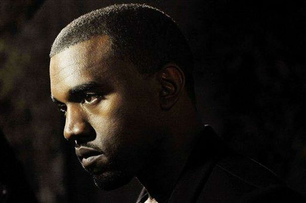 """Hip-hop artist Kanye West is pictured before a screening of """"Runaway,"""" a short film he directed that will accompany his forthcoming album """"My Beautiful Dark Twisted Fantasy,"""" Monday, Oct. 18, 2010, in Los Angeles. (AP Photo/Chris Pizzello)"""