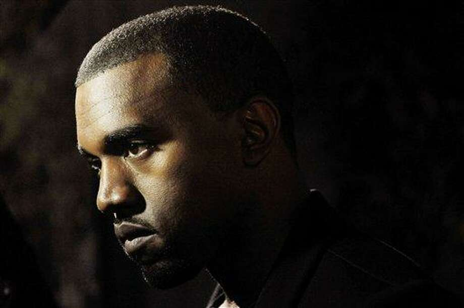 """Hip-hop artist Kanye West is pictured before a screening of """"Runaway,"""" a short film he directed that will accompany his forthcoming album """"My Beautiful Dark Twisted Fantasy,"""" Monday, Oct. 18, 2010, in Los Angeles. (AP Photo/Chris Pizzello) Photo: AP / AP"""
