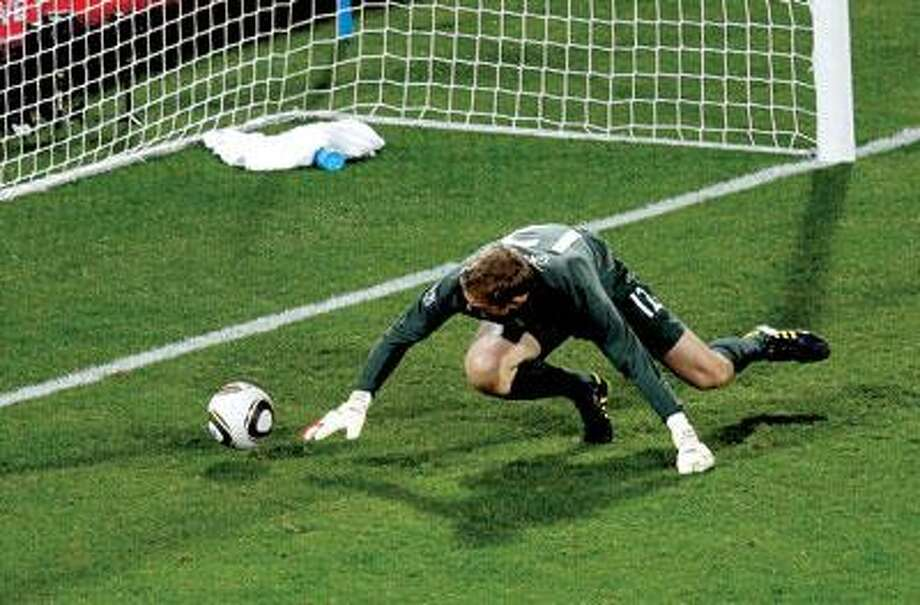 At top, England goalkeeper Robert Green fails to stop Clint Dempsey's shot during the 40th minute of an eventual 1-1 tie between England and the United States in a World Cup Group C match Saturday at Royal Bafokeng Stadium in Rustenburg, South Africa. (Associated Press)