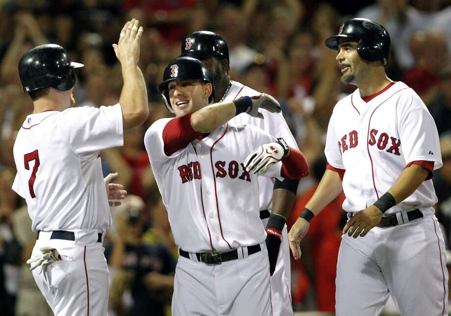 Ryan Kalish, center, is congratulated on his first career grand slam by Boston teammates J.D. Drew (7), David Ortiz, and Mike Lowell, right, during the fourth inning of the Red Sox's 6-0 win over the Los Angeles Angels Tuesday night at Fenway Park. (Associated Press) Photo: ASSOCIATED PRESS / AP