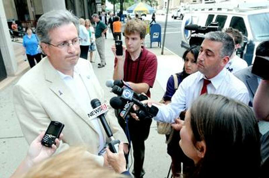 Dr. William Petit, Jr., (left) speaks to the press outside of Superior Court in New Haven during a break in the Steven Hayes trial on 8/18/2010. Photo by Arnold Gold