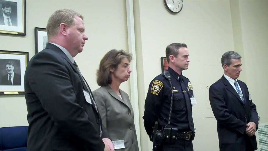 Appearing at Monday's Connecticut Freedom of Information meeting in Hartford were, pictured from right: Police Chief Keith Mello, Lt. Daniel Bothwell, Capt. Tracy Mooney, and Det. Richard Frawley  Photo by Brian McCready