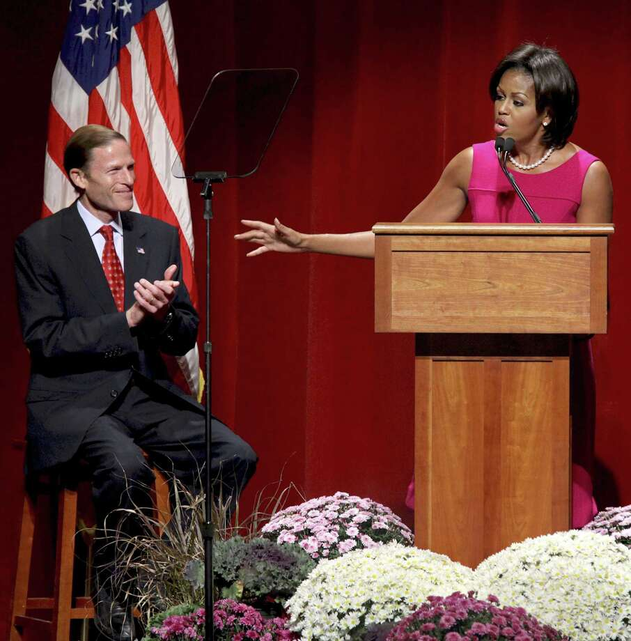 First lady Michelle Obama speaks on behalf of Connecticut Democrat Senate candidate Richard Blumenthal, during a campaign stop for Blumenthal's Senate bid,  Monday, Oct. 18, 2010, in Stamford, Conn.  (AP Photo/Craig Ruttle) Photo: AP / FR61802 AP