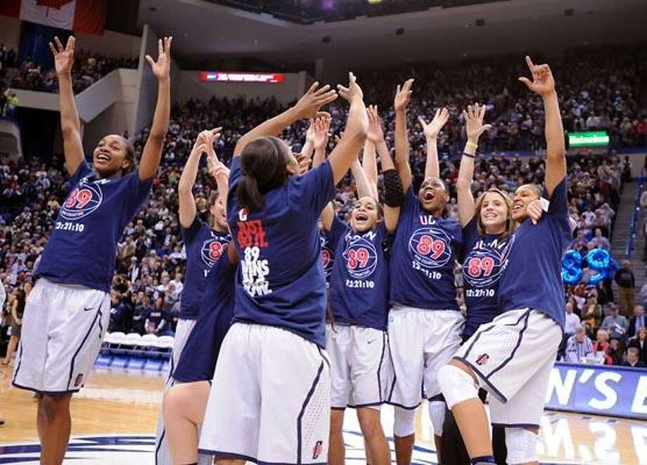 Hartford-- UCONN celebrates their 89th consecutive win. Photo by Peter Casolino/New Haven Register12/21/10 Cas101221