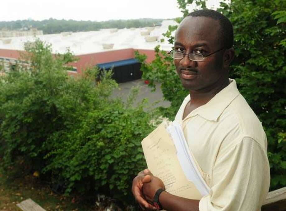Charles Okang and a Pheasant Road neighbor are suing Wal-Mart for not doing enough to reduce noice from their store and tire center. (Brad Horrigan/Register)