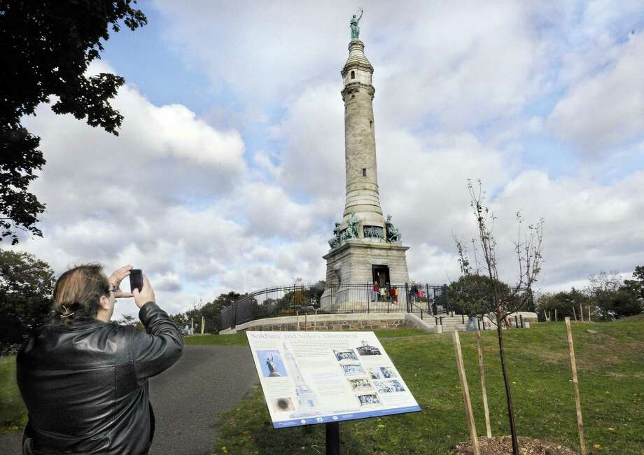 Former New Haven resident, Jason Epperson takes a picture of the rededicated Soldiers' and Sailors' Monument at East Rock Park.. He is visiting from Pennsylvania.    Melanie Stengel/Register