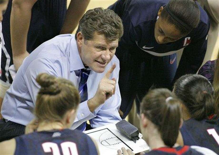 Connecticut head coach Geno Auriemma talks to players during a time-out against Georgia Tech during the second half of an NCAA basketball game, Sunday, Nov. 21, 2010, in Atlanta. Connecticut won 71-75.  (AP Photo/John Amis) Photo: AP / FR69715 AP