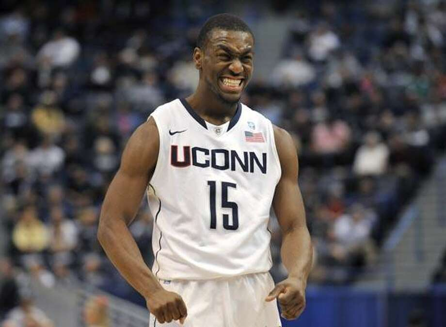 Connecticut's Kemba Walker reacts after he was fouled by Coppin State during the first half of an NCAA college basketball game, in Hartford, Conn., Monday, Dec. 20, 2010. (AP Photo/Jessica Hill) Photo: AP / AP2010