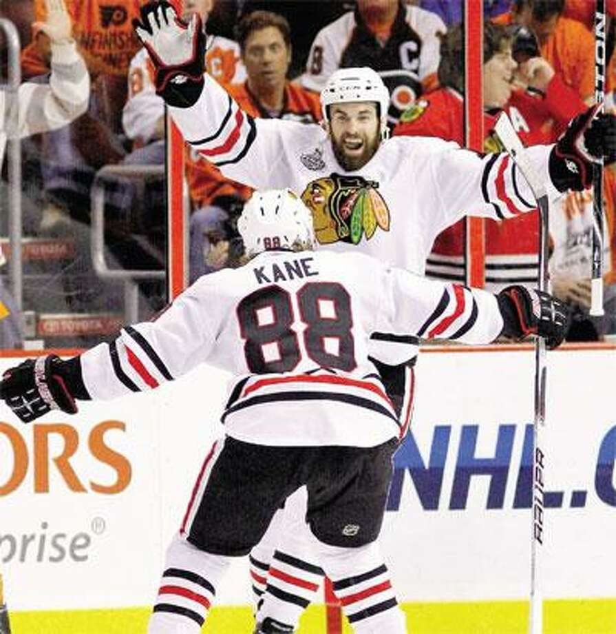 Chicago Blackhawks left wing Andrew Ladd celebrates with right wing Patrick Kane (88) after Ladd scored against the Philadelphia Flyers in the second period of Game 6 of the Stanley Cup finals Wednesday in Philadelphia. The Blackhawks beat the Flyers 4-3 in overtime and won the seven-game series 4-2 to capture the Stanley Cup. (Associated Press)