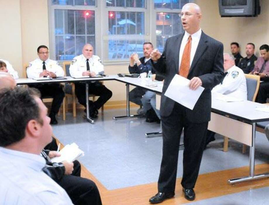 West Haven Police Chief John Karajanis Jr. speaks to a community block watch meeting Thursday night at police headquarters. (Peter Hvizdak/Register)
