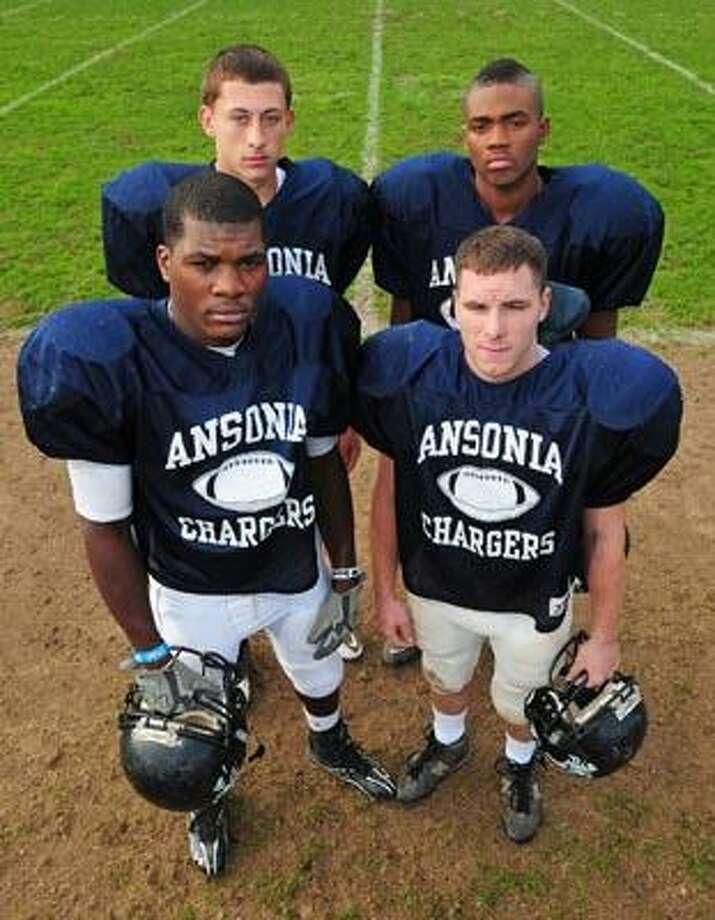 Ansonia football captains clockwise from top left:  Jake LaRovera, Matthew Hall, Dennis Danley and Montrell Dobbs. (Brad Horrigan/Register)