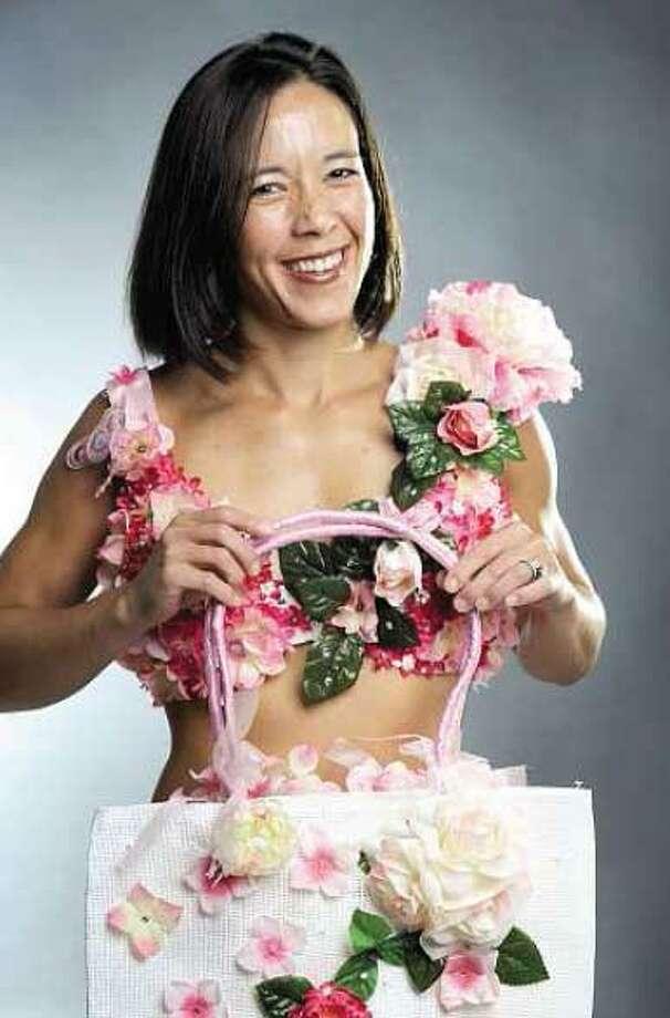 """Annette Hubbard, left, models Francine Poleshuk's """"Take It Slow"""" art bra. (VM Williams/Register)"""