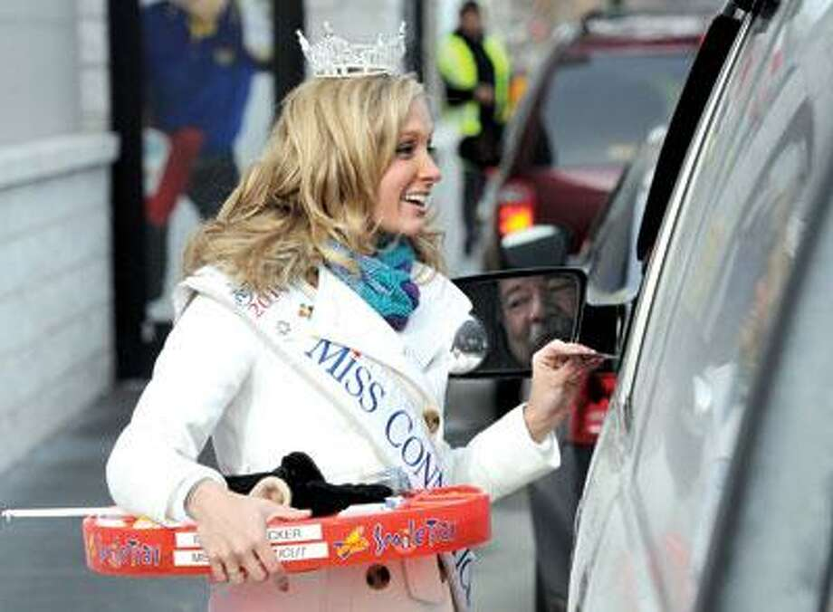 Miss Connecticut Brittany Decker spent a frigid afternoon at the Sonic restaurant in Wallingford raising money for the Connecticut Children's Medical Center. Here she speaks with Mark Butterworth of North Haven. She'll compete in the Miss America Pageant in January. (Mara Lavitt/NewHaven Register)