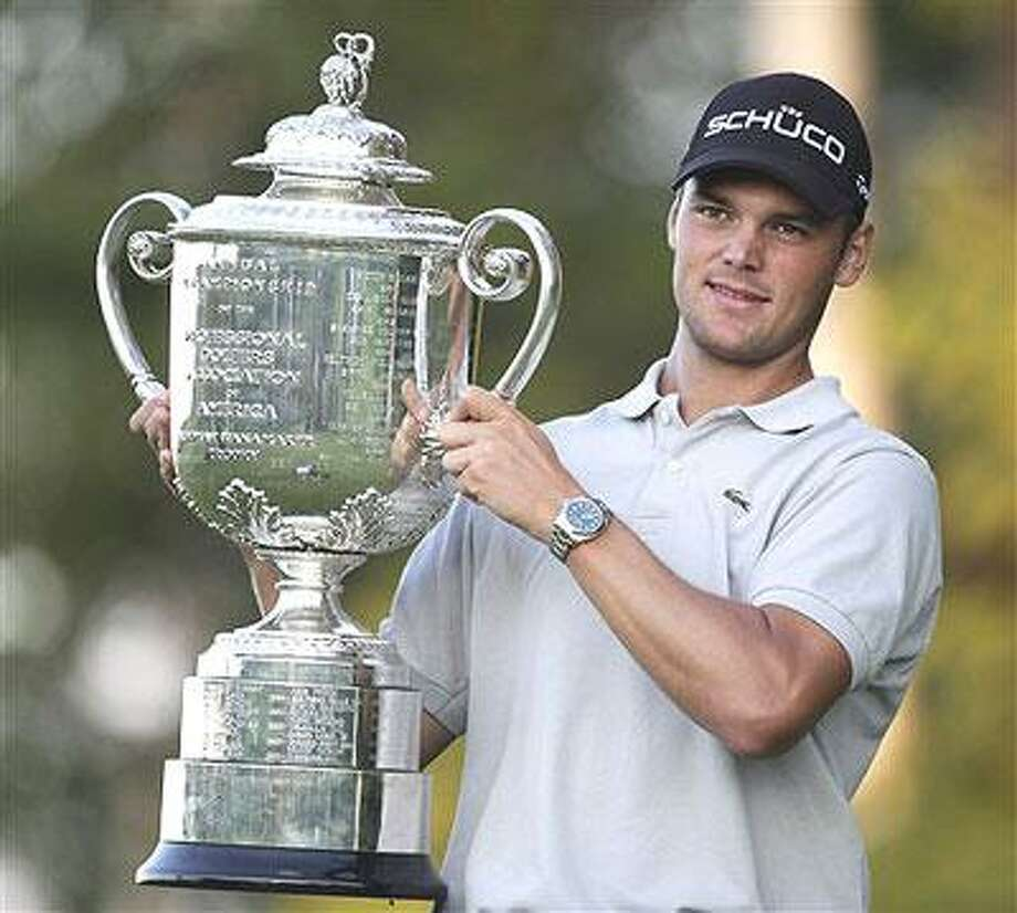 Martin Kaymer of Germany holds the Wanamaker Trophy after winning a playoff in the PGA Championship golf tournament Sunday, Aug. 15, 2010, at Whistling Straits in Haven, Wis. (AP Photo/Charlie Neibergall)