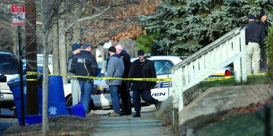 Emergency personnel are photographed in front of a residence at 17  Hubinger St. in New Haven where explosives were found on 12/16/2010. (Arnold Gold/New Haven Register)