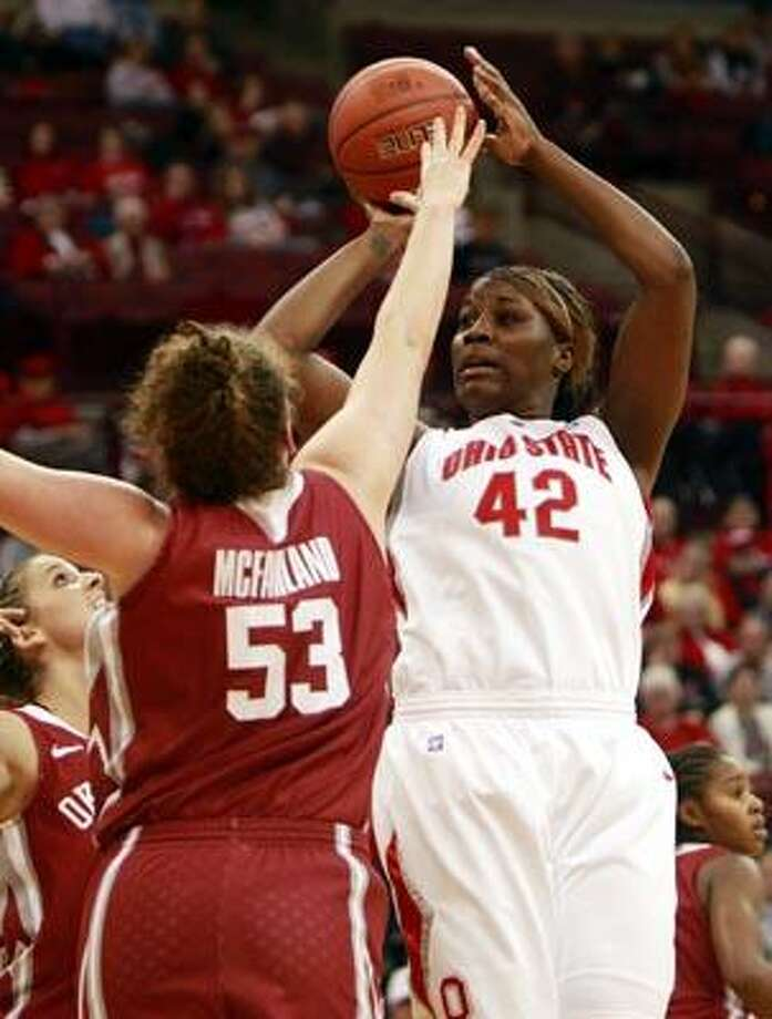Ohio State's Jantel Lavender (42) shoots over Oklahoma's Joanna McFarland (53) during the second half of an NCAA college basketball game Sunday, Dec. 5, 2010, in Columbus, Ohio. Ohio State won 95-84. (AP Photo/Terry Gilliam) Photo: AP / FR10910 AP
