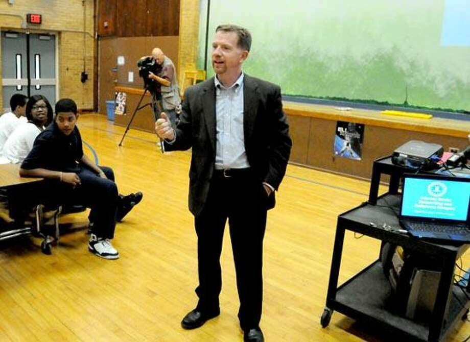 """F.B.I. Special Agent Ron W. Offutt speaks to MicroSociety Magnet School students and staff   Tuesday on the topic of cyber bullying, """"Internet Social Networking and Cellphone Dangers."""" (Photography by Peter Hvizdak)"""