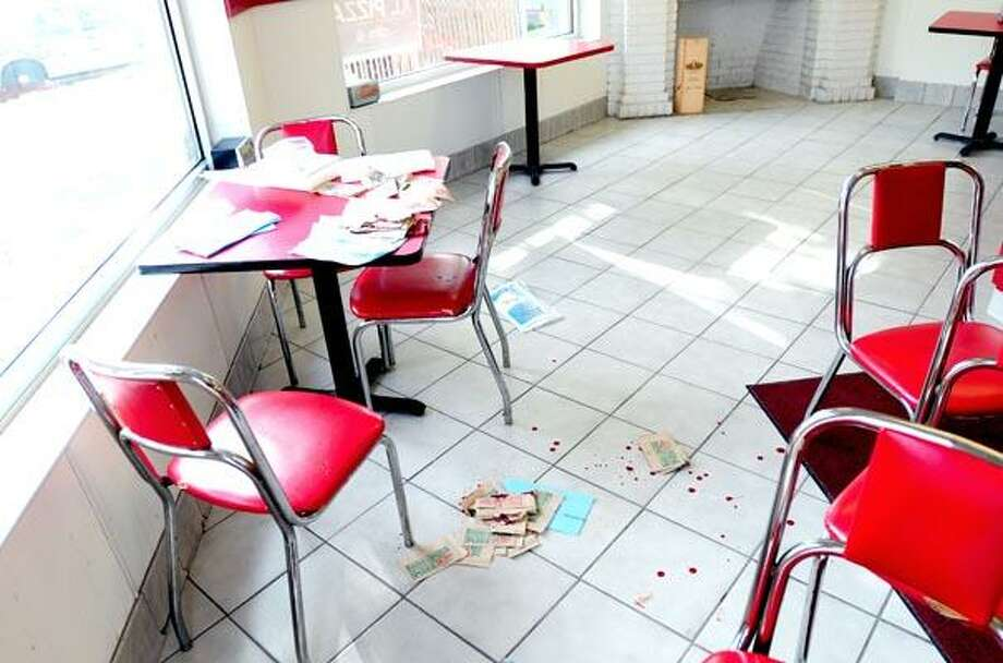 Blood splatters the floor around the table at Papa John's on Whalley Ave. in New Haven where a stabbing victim was helped on 10/12/2010.Photo by Arnold Gold      AG0388A