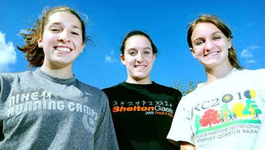 From left, Shelton cross country captains Kelsey Murphy, Melissa Corraro and Kelsey Grimmer. (Arnold Gold/Register)
