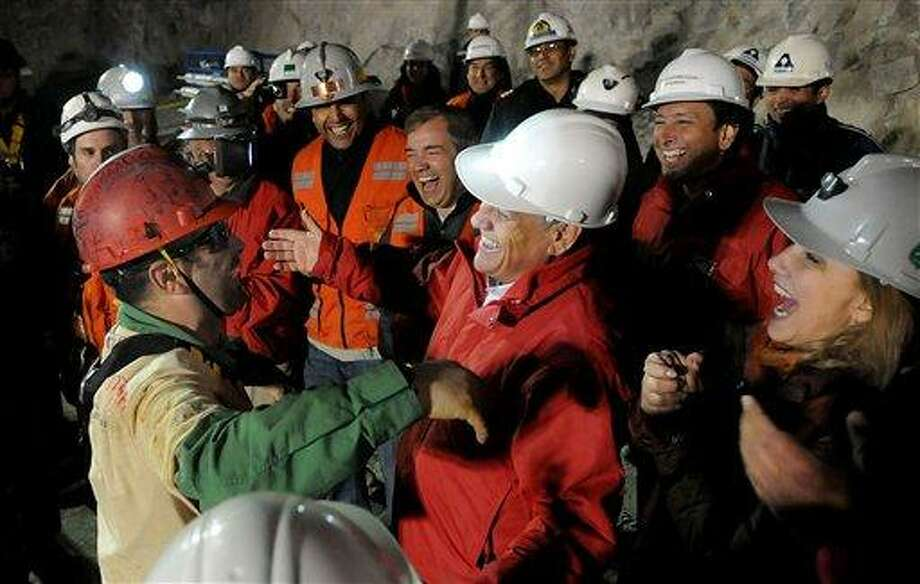 In this photo released by the Chilean presidential press office, Chile's President Sebastian Pinera, center right, greets the second rescued miner Mario Sepulveda after he was rescued from the collapsed San Jose gold and copper mine where he was trapped with 32 other miners for over two months near Copiapo, Chile, early Wednesday Oct. 13, 2010. (AP Photo/Jose Manuel de la Maza, Chilean presidential press office) Photo: AP / Chilean Presidential Press Office