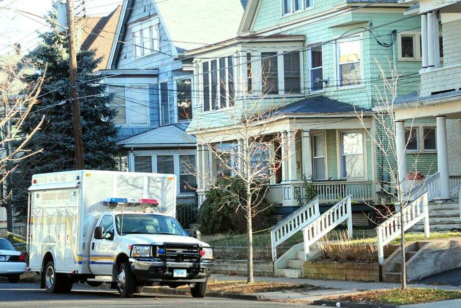 Explosives were found at a home on 17 Hubinger St. (green house at right) in New Haven on 12/16/2010.Photo by Arnold Gold/New Haven Register    AG0396B