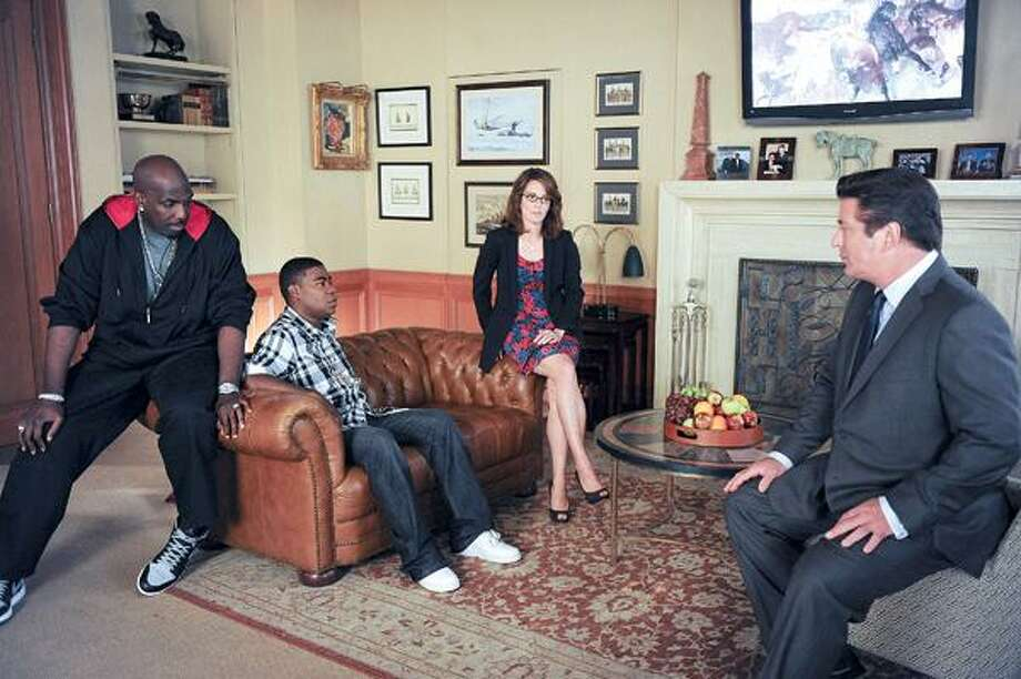 """NBC photo, From left, in last week's episode of """"30 Rock,"""" are Kevin Brown as Dotcom, Tracy Morgan as Tracy Jordan, Tina Fey as Liz Lemon and Alec Baldwin as Jack Donaghy."""